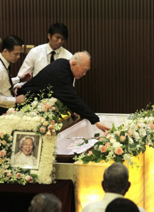Mr Lee's love for Madam Kwa was evident as he placed a kiss on his wife lying in her casket - Photo Credits: ST